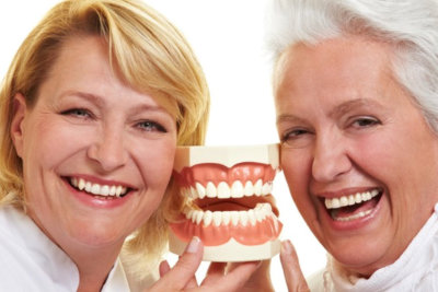 a nurse and an elderly smiling