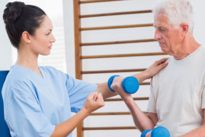 a nurse helping an elderly exercise