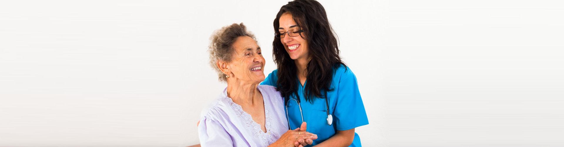 nurse and caregiver are smiling